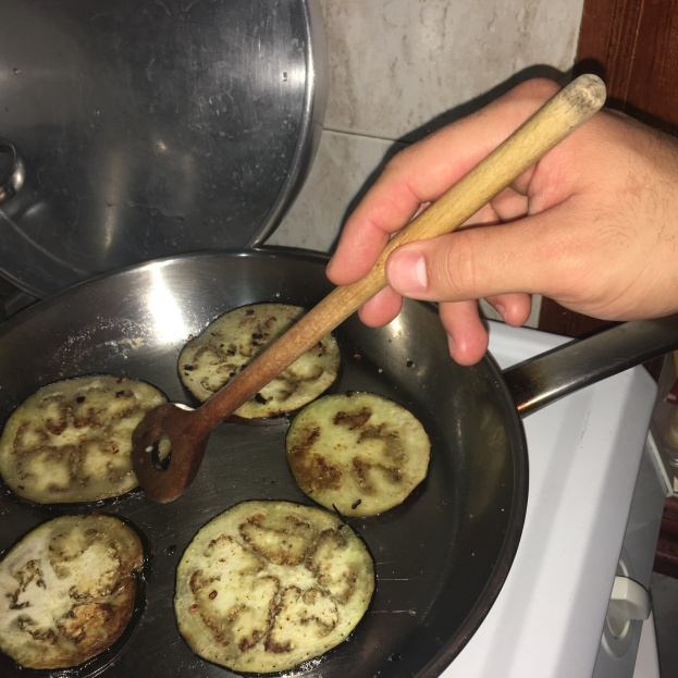 David pan frying eggplant.