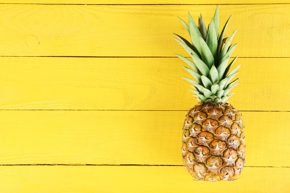 Pineapple on yellow boards.
