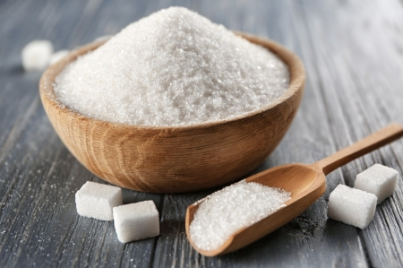Bowl and scoop of white sugar.